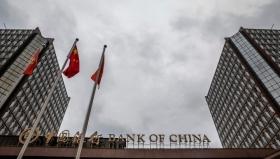 Банк Китая ослабил курс